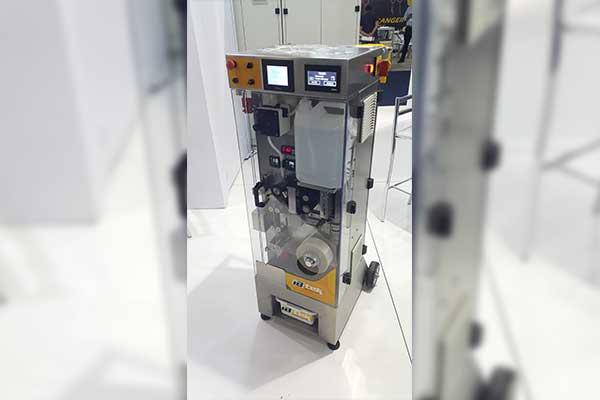 Máquina seladora de sachê de mel